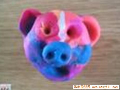 老虎机是什么东西:儿童橡皮泥手工作品:猪头